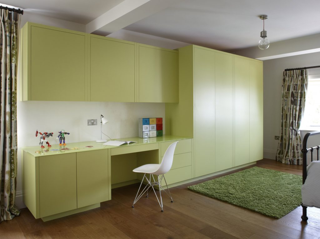 Contemporary lime-green cabinetry desk in childs room