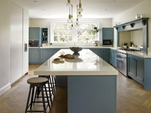 Shaker style Blue Kitchen with streamlined handleless cabinetry