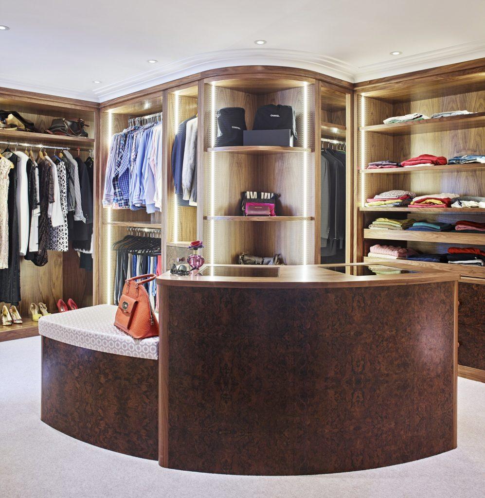 Curved walnut Walk in Wardrobe by Chamber Furniture