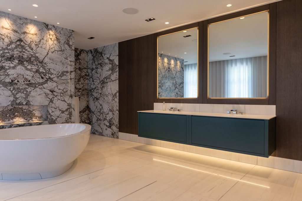 Floating vanity unit with flushed mirrors into stained grey oak wall