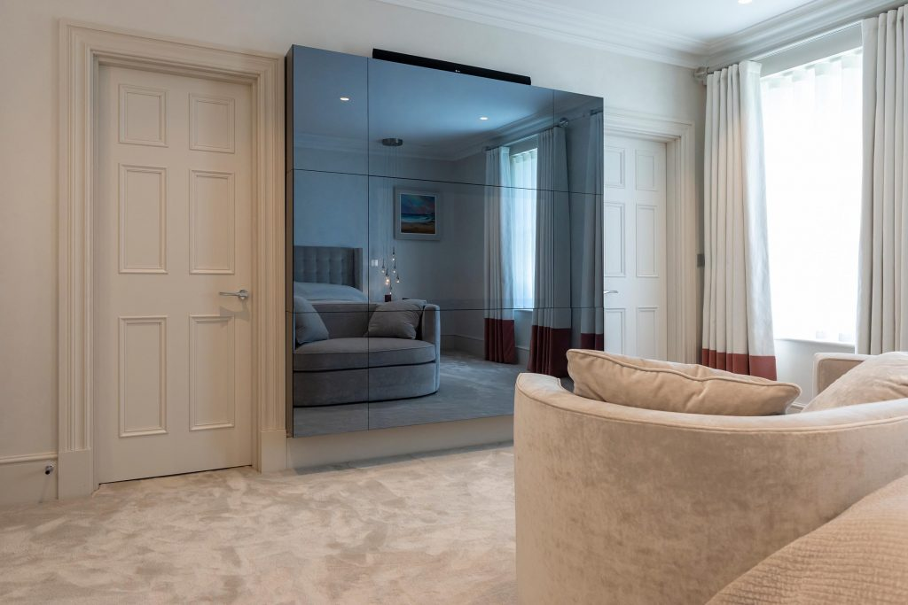 Floating mirror box conceals entertainment system