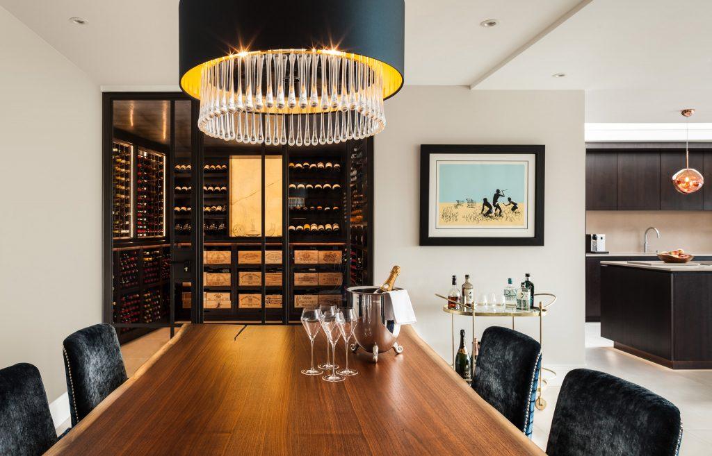 Fully conditioned walnut Wine Racks set behind black Crittal glass doors