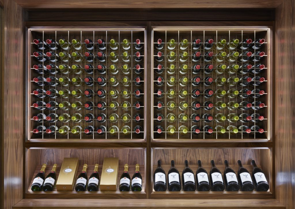 Lasercut bronze panels set into walnut Wine Display Cabinets