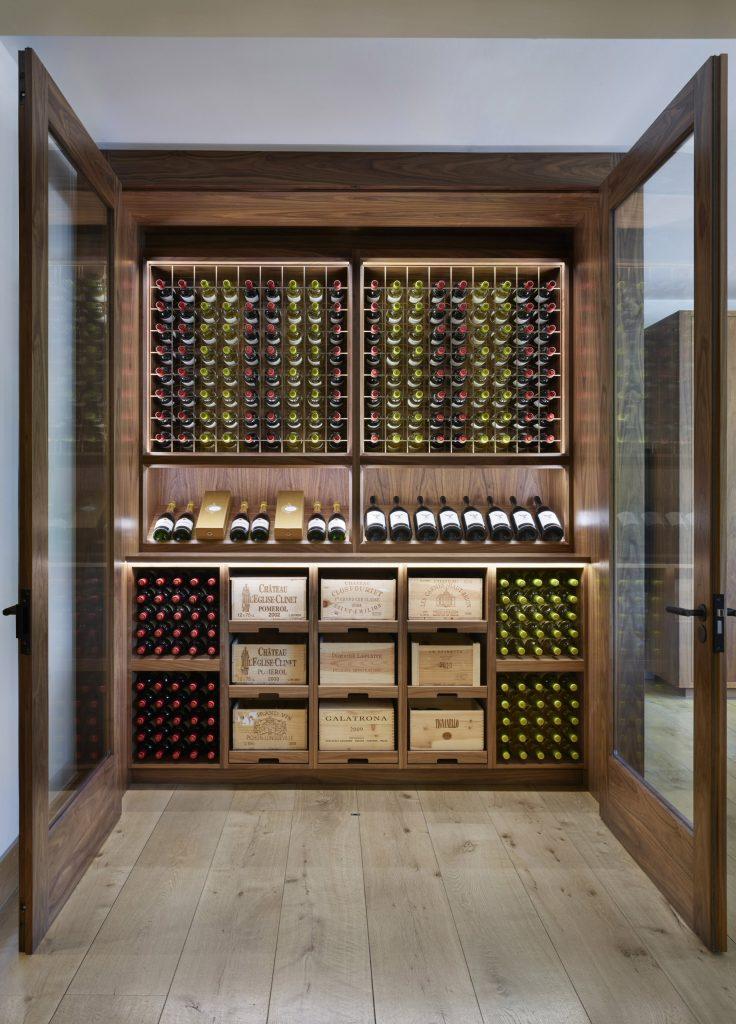 Lasercut bronze panels set into walnut Wine Display Cabinets with LED lighting