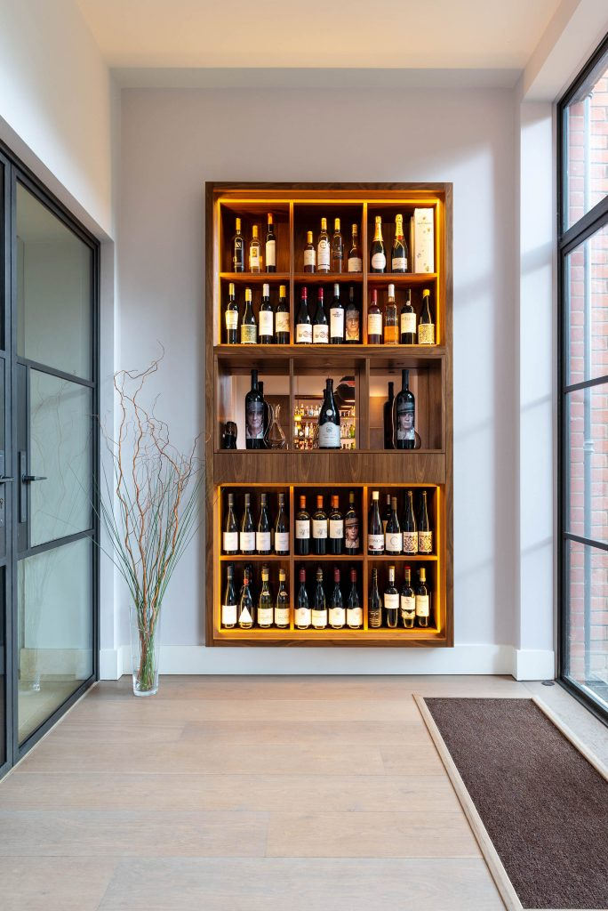 Kitchen Architecture with contemporary framed walnut wine disply