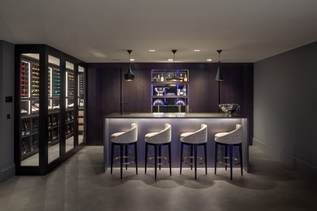 Sophisticated home bar area is finished in stained oak and pewter liquid metal